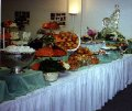 Wedding Buffet Table with Ice Sculpture of a Swan